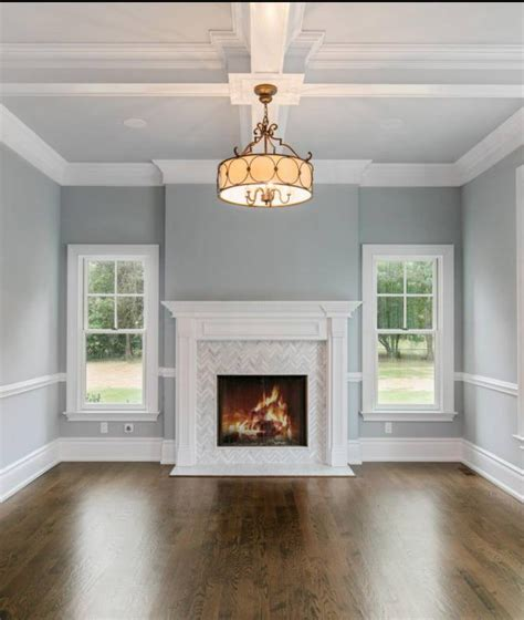 fireplace mantel designs in simple and sophisticated style gas fireplace with herringbone marble tile and simple