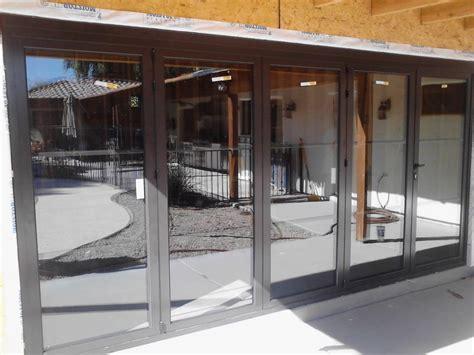 creating sun room enclosure  sliding glass doors