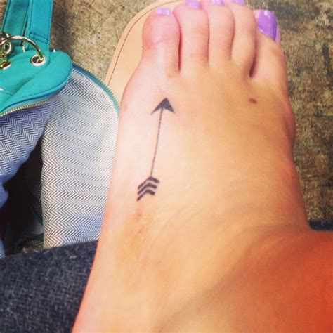side foot tattoos another arrow foot i believe written on
