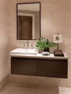 Small Black Bathrooms - how to take advantage of floating vanities to make bathrooms spacious