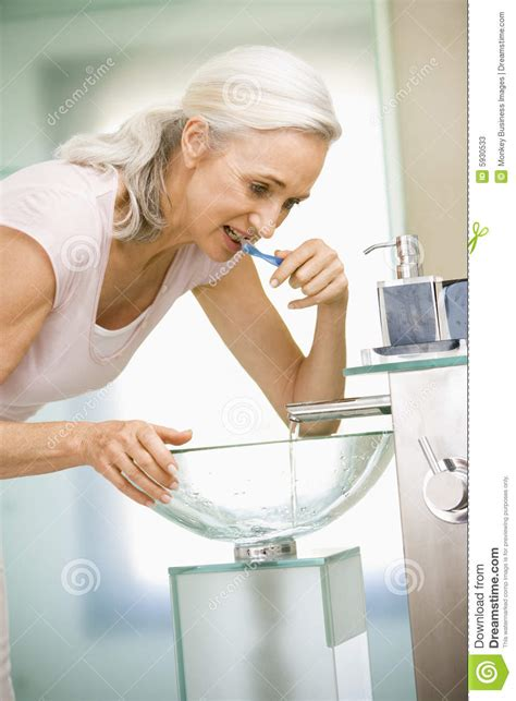 woman in bathroom woman in bathroom brushing teeth stock photos image 5930533