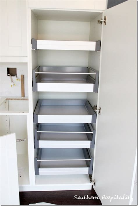 pull out shelves for kitchen cabinets ikea week 18 house renovation stainless steel and white