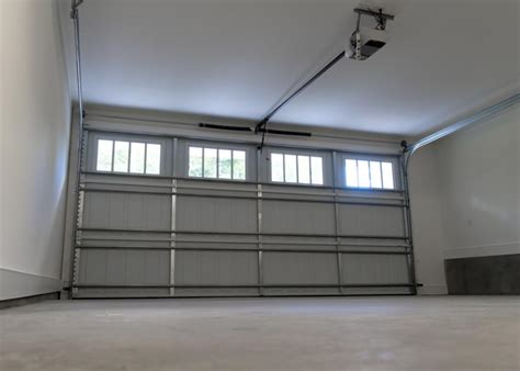 traditional garage door vs roll up door which one is