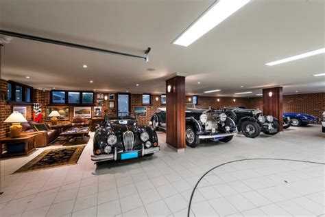 French Provincial Kitchen Design by Luxury Garage Car Turntable Adds Extra Twist