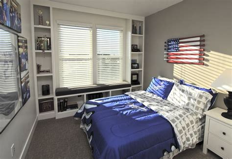 sporty dodgers room with built in bookshelves and window