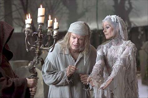 kelsey grammer a christmas carol alexander krakowski and martin haunt grammer s scrooge in