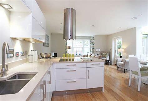 white  grey kitchen  warm wooden floors white