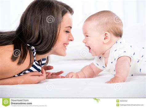 mom son bed mom and baby stock photo image 46343452