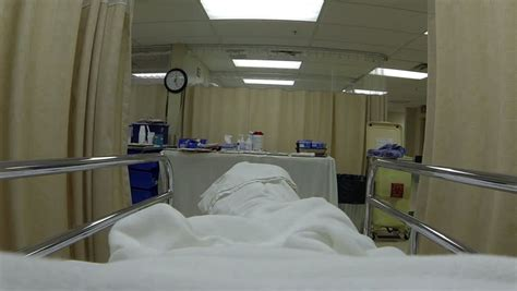 hospital bed patient after emergency surgery hd