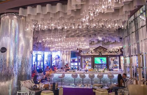 cosmopolitan chandelier bar city guide las vegas the way the perennial style