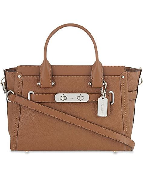 Coach Swagger Size 26 Tas Branded coach swagger 27 pebble leather tote in brown lyst