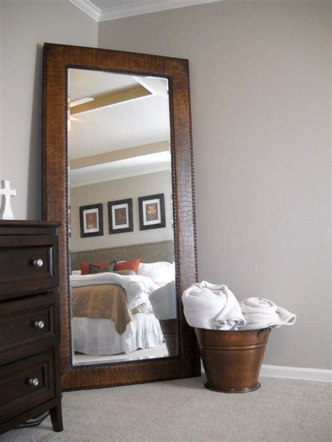 large bedroom mirror leaner mirror with brown wooden frame on wheat floor