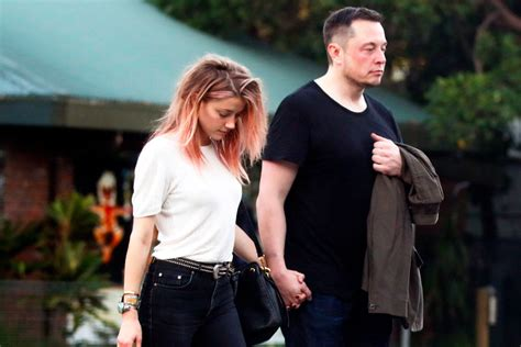 amber heard and elon musk confirm relationship with pda amber heard and elon musk photographed together page six