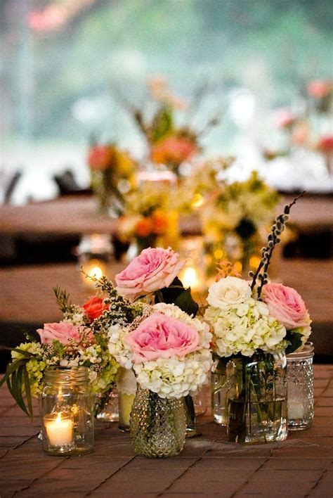small vases with floral groupings simple but beautiful