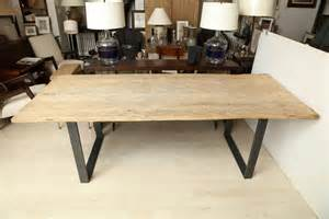 large reclaimed elm wood dining table with steel base at