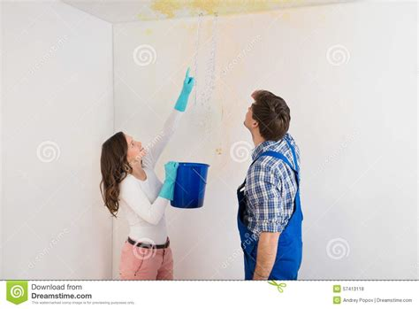 leaking ceiling stock images royalty free images woman showing water leaking from ceiling to maintenance