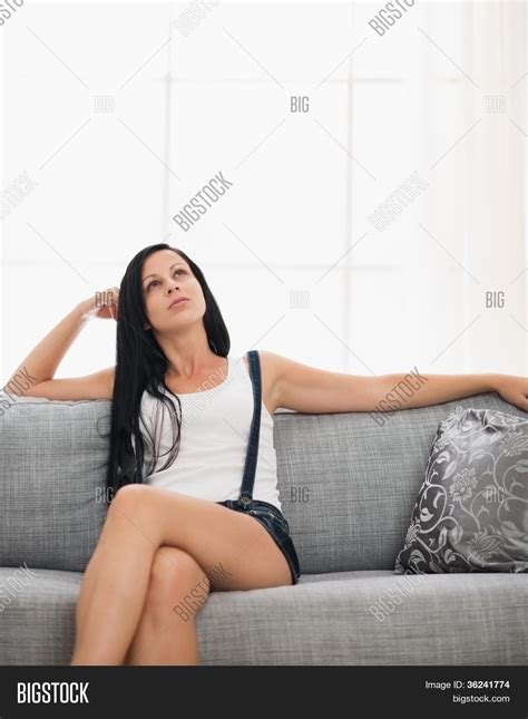 girl sitting on couch thoughtful girl sitting on couch image photo bigstock