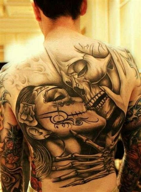 skull kissing tattoo 1000 images about ideas on