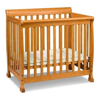 Davinci Kalani Mini Crib White Kalani Mini Crib In Honey Oak M5598o By Davinci Baby Cribs At Simplykidsfurniture