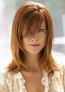 hairstyles wiyh swept away bangs more layered medium length hairstyle with side swept long