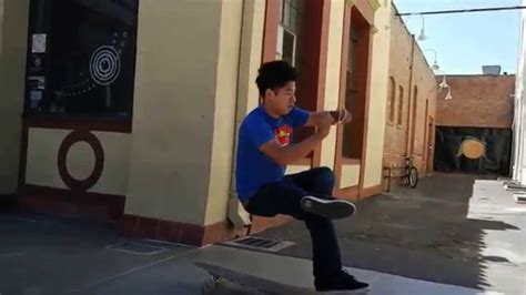 magician sits on an invisible chair prank