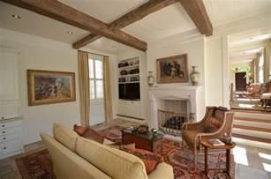 Wood beam ceilings living room traditional with herringbone pattern