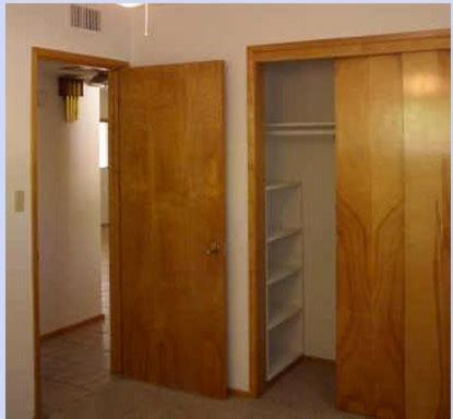 How To Paint A Wooden Wardrobe White by Painting Dated Closet Doors