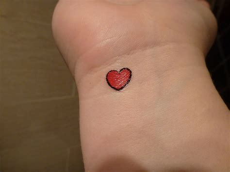 red heart tattoo tiny on wrist
