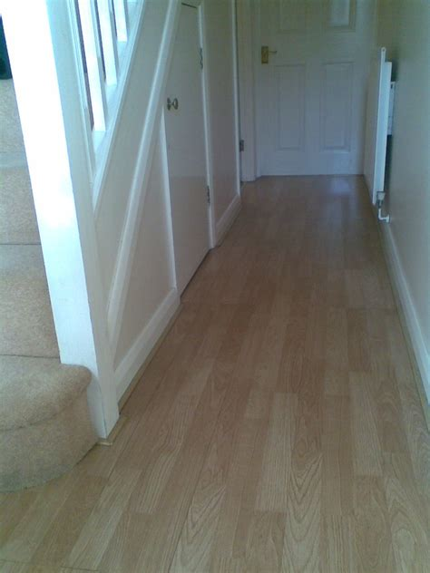 Laminate flooring hiding exp gap under skirt   Flooring
