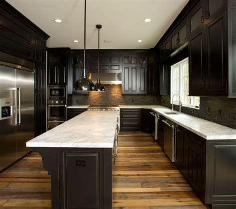 dark kitchen cabinets with dark hardwood floors reclaimed wood floors w dark cabinets our first place