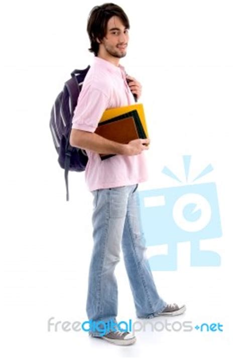standing sideways books standing boy holding books and bag stock photo royalty