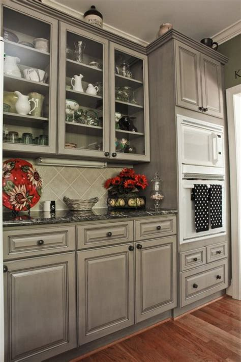 beautiful gray cabinets to compliment the black countertops and white appliances that we