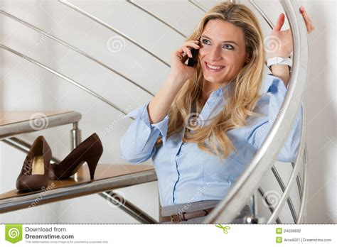 businesswoman a phone call at home stock
