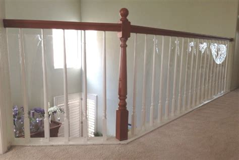 Safety Gates For Stairs With Banisters Balcony And Banisters Photo Gallery Baby Safe Homes