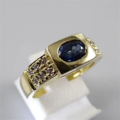 Blue Sapphire 0 7 Ct 18k s band ring with 0 45 ct blue sapphire and 0 12 brilliant cut 5 7 grams ring