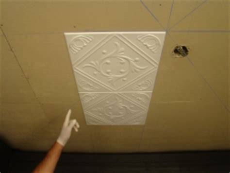 how to put up ceiling tiles how to install glue up faux tin ceiling tiles diy from