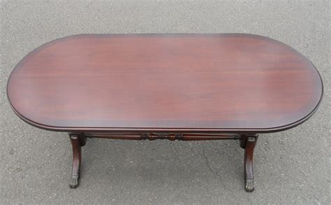 oval mahogany pedestal coffee table by strongbow