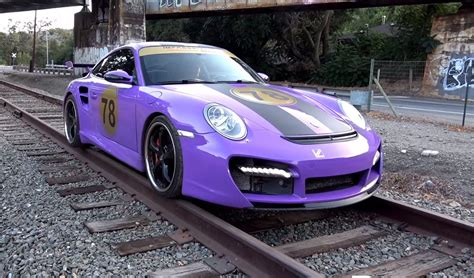 purple porsche 911 turbo purple porsche 911 turbo drives on train track