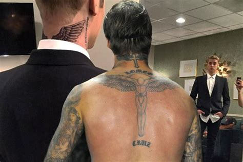 bieber neck tattoo justin bieber gets david beckham with wings