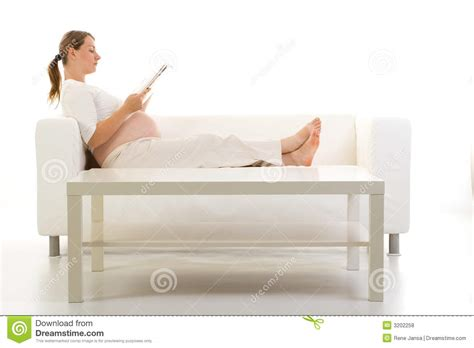 pregnancy couch pregnant woman on the couch royalty free stock photos