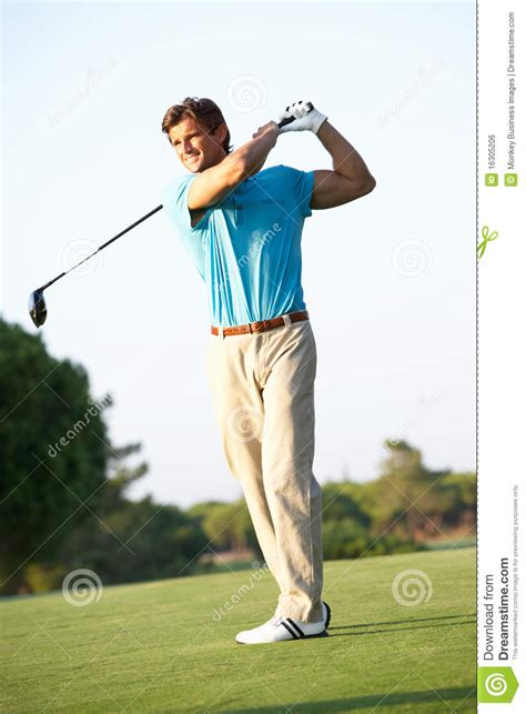 male golfer teeing   golf  royalty  stock