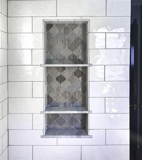 arabesque tile shower shelf niche white subway shower tile