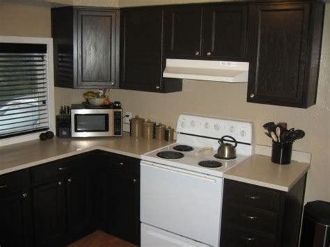 painting kitchen cabinets using rust oleum cabinet painting laminate cabinets clever ideas aha pinterest