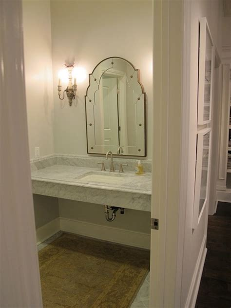 glam powder room with floating mirrored vanity