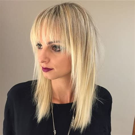 hairstyles blonde with fringe women s long blonde shaggy layered cut with fringe bangs
