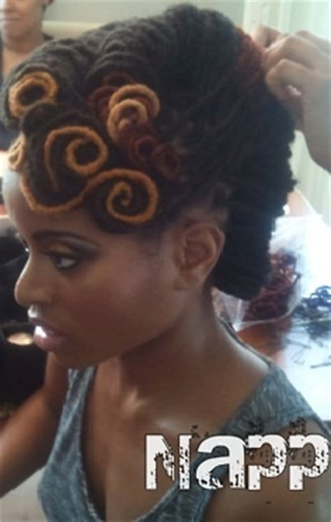 french roll short dreads locs have pin curls in the front and two french rolls in