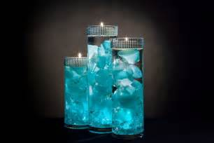 Wedding Flower Vases Wholesale - teal floral centerpieces with led lights and floating candles