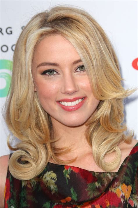 2013 hairstyles that make you look younger is short hair instyle for women fall 2013 short