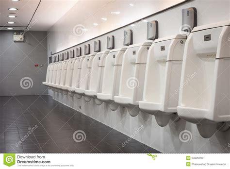 male public bathroom indoor white urinals men public toilet stock photo image