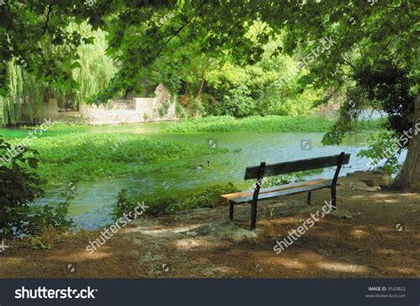 stream bench bench beside a mountain stream stock photo 9520822 shutterstock